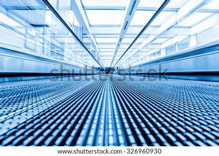 Close-up of moving escalator,motion blur - stock photo