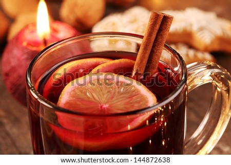 Close-up of mug with mulled wine and gingerbread cookies. - stock photo