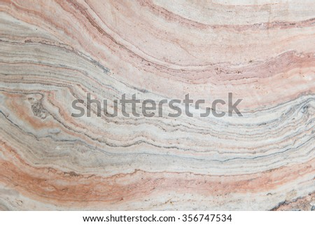 Close up of multi color stone wall backgroud - stock photo