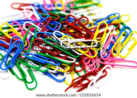 Close-up of multi-colored paper clips on a white background