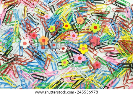 Close-up of multi-colored paper clips with flower foam - stock photo