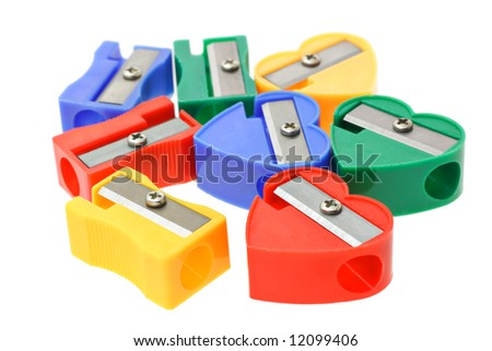 Close up of multicolors pencil sharpeners on white background