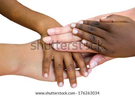 Close up of multiethnic children's hands making pile against blue sky. - stock photo