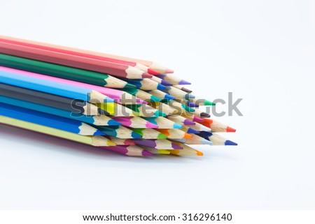 Close up of multiple colors wooden pencil on white background - stock photo