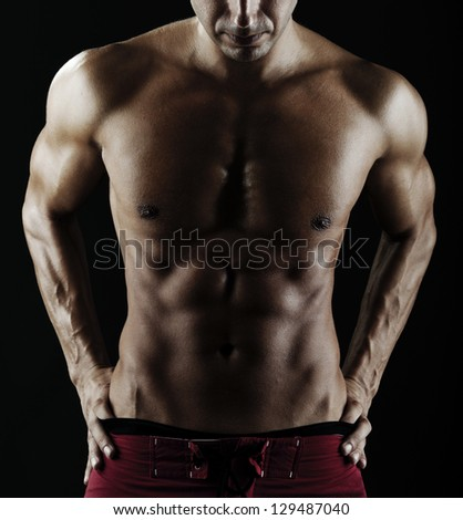 Close up of muscular male torso - stock photo