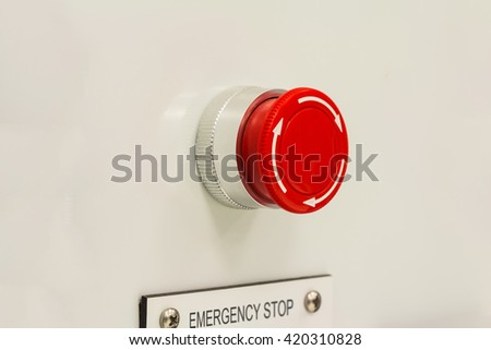 Close up of mushroom type emergency stop button switch, an electrical device for safety - stock photo
