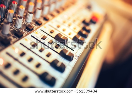 Close-up of music mixer button, setting volume. Music production mixer, adjustment tools - stock photo