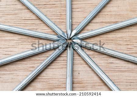 close up of nails star shape on wood background - stock photo