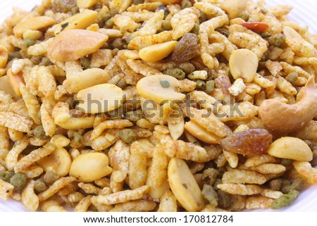 close up of Navaratanmix,A combination of dried nuts blended with beaten rice and gram flour balls.a popular Asian snack. - stock photo