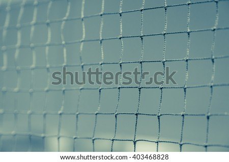 Close up of net in badminton court for sport background fade vintage filter - stock photo