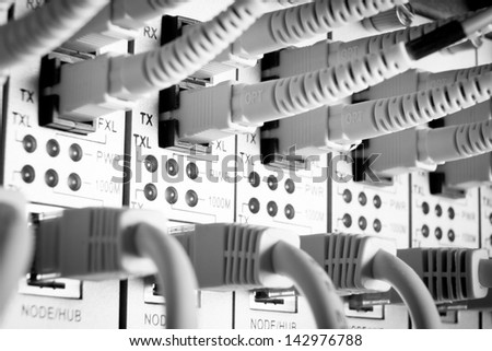 close up of network cables connected to switch - stock photo