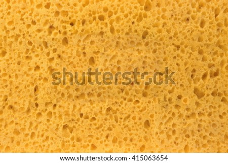 Close-up Of New And Clean Yellow Sponge Textured Background With Copy Space - stock photo