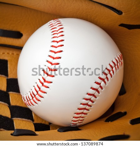 Close-up of new baseball in a glove. Clipping path included - stock photo
