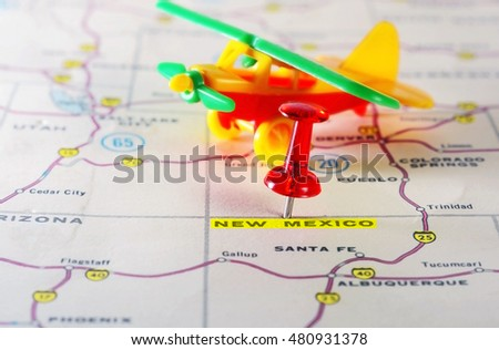 Close up of  New Mexico  USA map with red pin and airplane  toy - Travel concept
