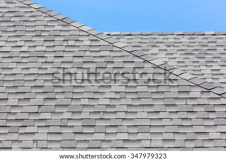 Close Up Of New Rubber Roof Tiles With Blue Skybackground.