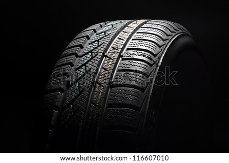 Close up of new winter tire on black - stock photo