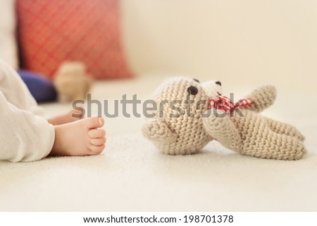 Close up of newborn baby girl's feet - stock photo