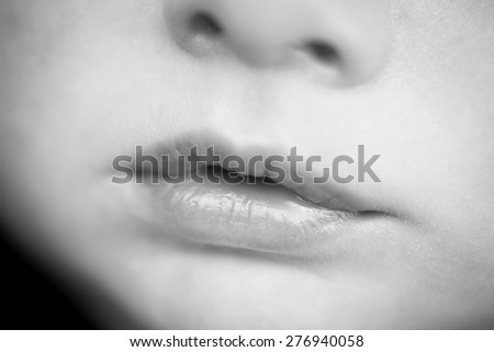 Close up of newborn baby mouth - stock photo