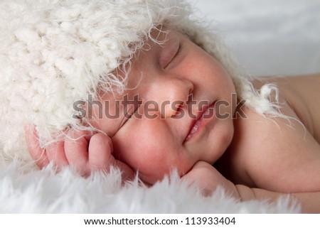 Close Up of newborn baby peacefully sleeping - stock photo