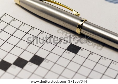 Close up of newspaper, focus in CROSSWORD - stock photo
