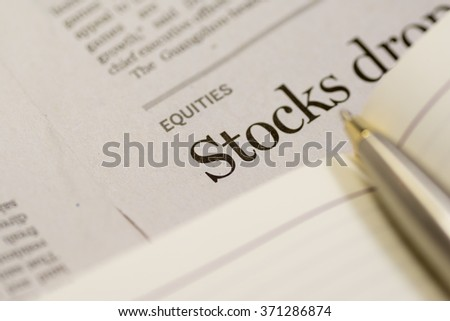 Close up of newspaper, focus in STOCK - stock photo