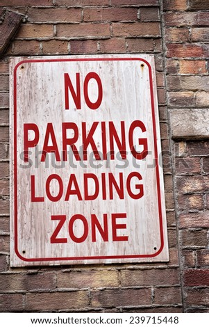 Close up of no parking loading zone, selective focus.  - stock photo