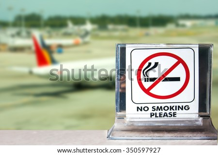 close-up of no smoking warning over airport background,abstract background for no smoking concept.