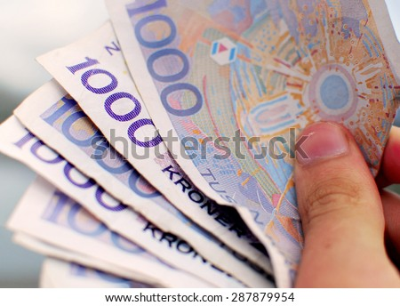 Close Up Of Norwegian Bank Notes - Money Norwegian thousand kroner bills/notes. The 1000 kr bank note is the largest amount of money to be found on paper in Norway. - stock photo