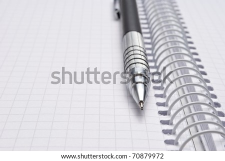 Close-up of notebook and pencil - stock photo