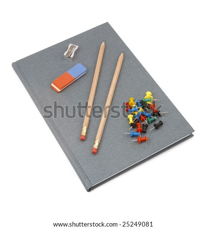 close up of notebook, pencils, sharpener, eraser and push pins on white background with clipping path - stock photo