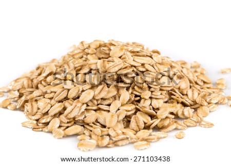 close up of oatmeal flakes on white background - stock photo