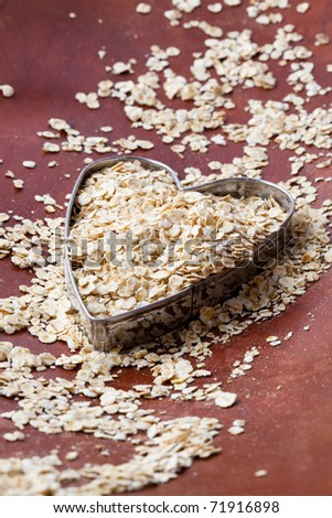 Close-up of oats in a heart shape cutter - stock photo