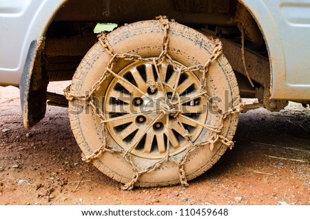 close up of off road car tire with chain on it - stock photo
