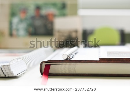 Close-up of office desk with shallow depth of field - stock photo