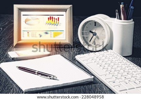 Close up of office workplace with notepad and keyboard - stock photo