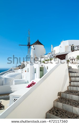 Close up of Oia with a windmill - Greece