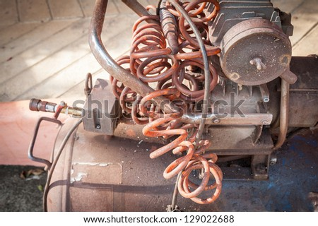 close up of old air compressor - stock photo