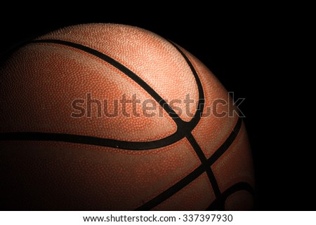 Close up of old basketball on black background