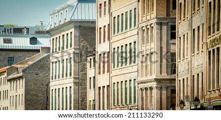 Close up of old buildings in old port of Montreal, Quebec - stock photo