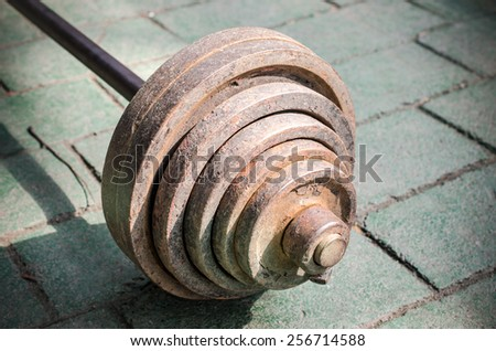 Close up of old dumbbell. Outdoor view /Old dumbbell/ Close up of old dumbbell. Outdoor view (dumbbell, rust, weights) - stock photo