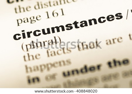 Close up of old English dictionary page with word circumstances - stock photo