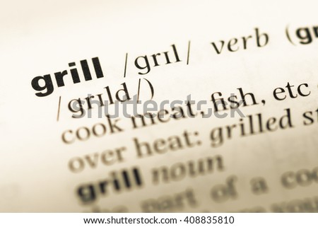 Close up of old English dictionary page with word grill