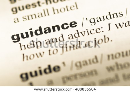 Close up of old English dictionary page with word guidance - stock photo