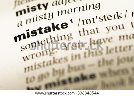 Close up of old English dictionary page with word mistake - stock photo