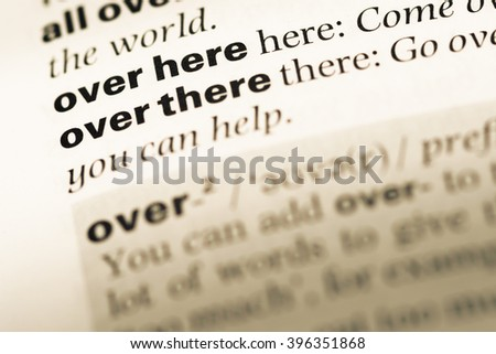 Close up of old English dictionary page with word over there - stock photo