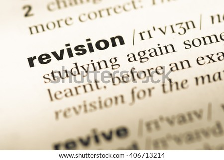 Close up of old English dictionary page with word revision - stock photo