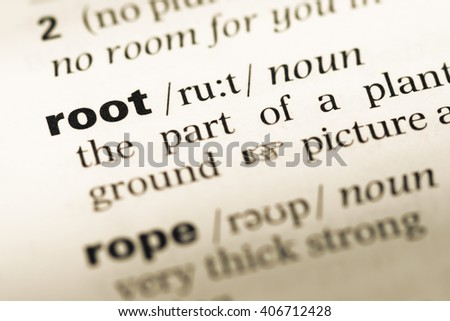 Close up of old English dictionary page with word root - stock photo