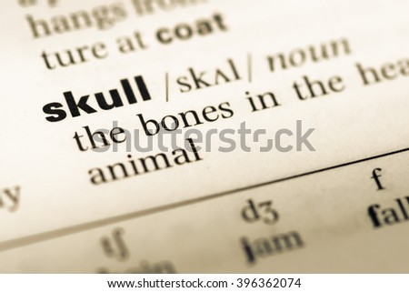 Close up of old English dictionary page with word skull