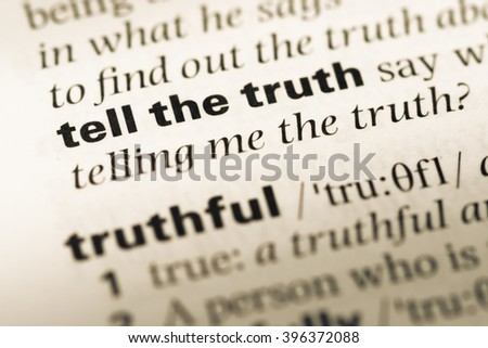 Close up of old English dictionary page with word tell the truth - stock photo