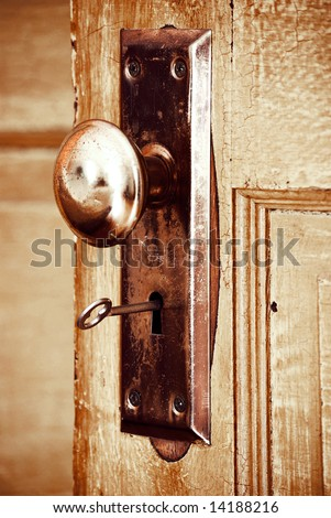 close-up of old-fashioned key in a door